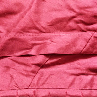 Figure  Hem tuck and clipped facing as seen from front.